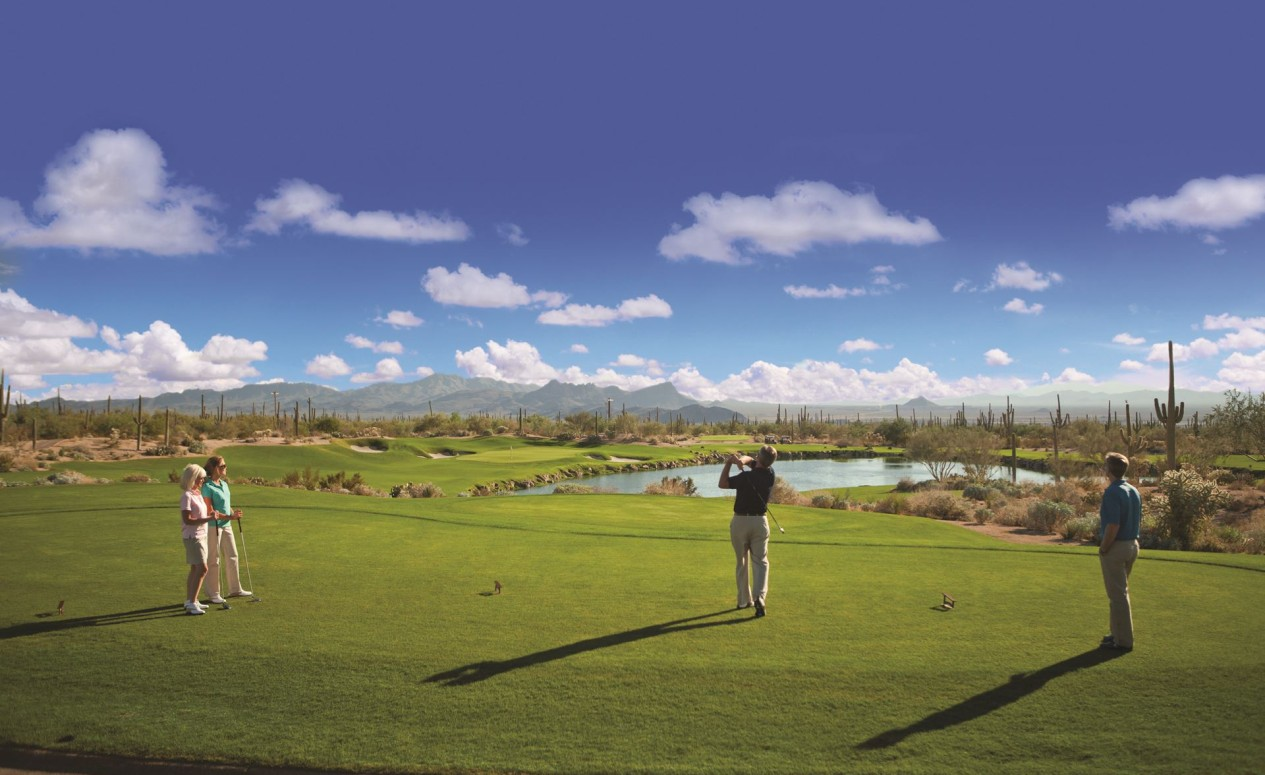 Two women and two men playing golf. The Ritz-Carlton Residences is a highly-customized, whole-ownership, private luxury Dove Mountain real estate community.