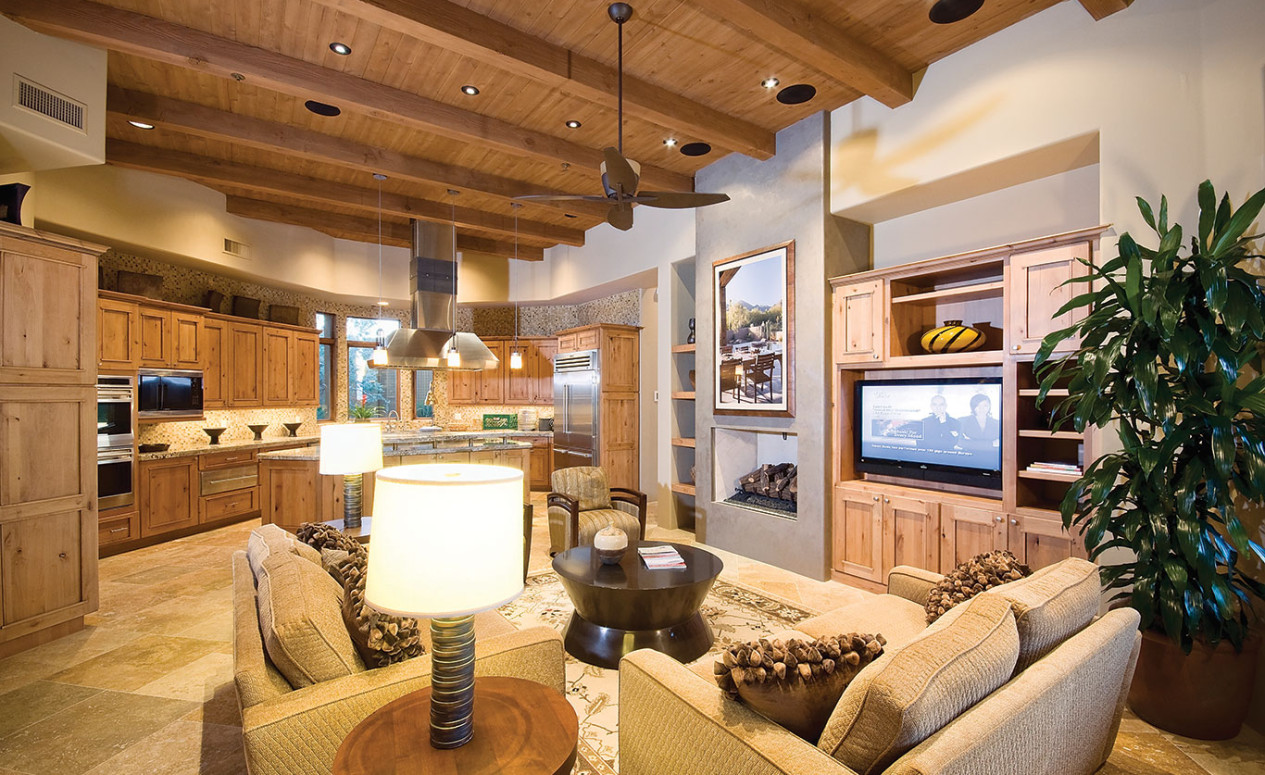 Interior living room and kitchen, open floor plan. Dove Mountain real estate at its finest, at The Ritz-Carlton Residences, Dove Mountain.