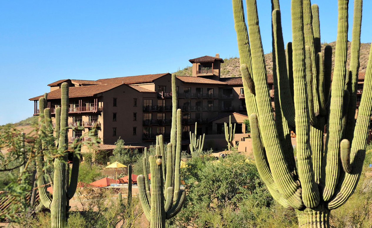 The Ritz-Carlton Resort, as seen through Saguaro cacti. Homeowners of The Residences luxury homes at Dove Mountain can access these amenities any time.