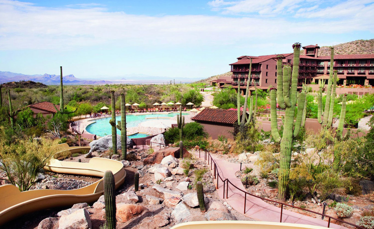 Pool with slide at The Ritz-Carlton Resort. Homeowners at The Residences luxury Dove Mountain real estate can enjoy the resort pool whenever they wish.