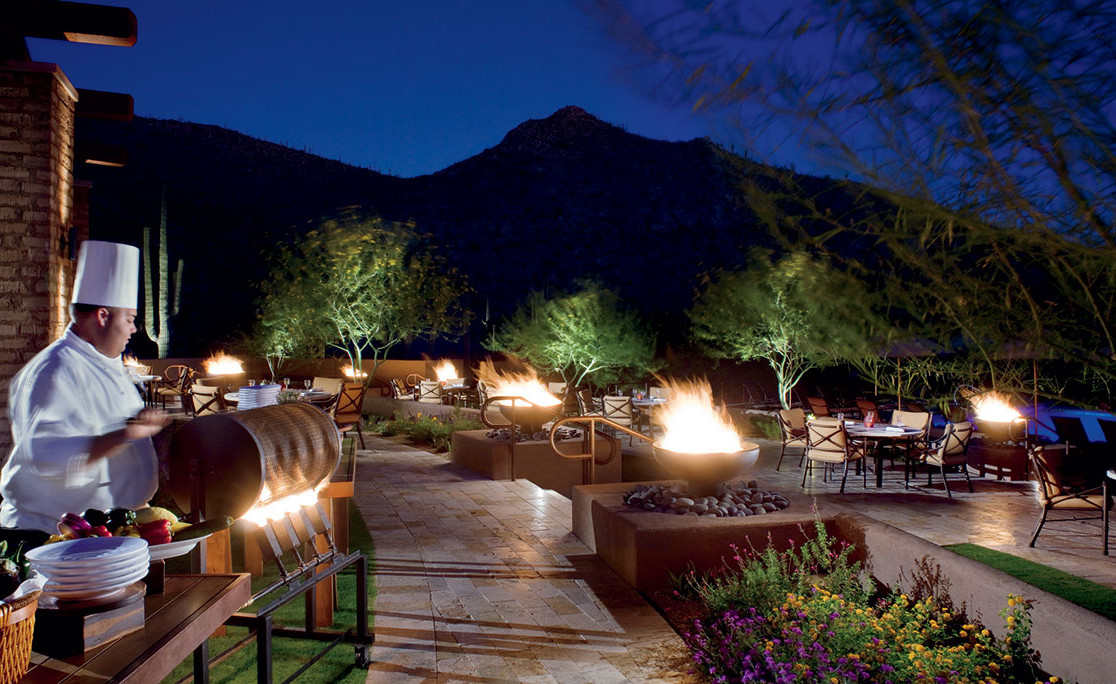 Chef grilling outdoors at the restaurant at The Ritz-Carlton Resort. Visit The Residences today to learn more about our Dove Mountain homes for sale.